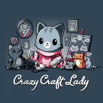 Crazy Craft Lady t-shirt TeeTurtle denim blue t-shirt featuring a gray stripped cat in a pink cat sweaters with tons of cat crafts all around them - paintings, pictures, stuffed animals, etc.