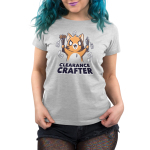 Clearance Crafter Women's t-shirt model TeeTurtle silver t-shirt featuring a crazy looking orange cat with big eyes and a big smile holding pencils and paint brushes with a bunch of sale tags on them