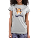 Clearance Crafter Junior's t-shirt model TeeTurtle silver t-shirt featuring a crazy looking orange cat with big eyes and a big smile holding pencils and paint brushes with a bunch of sale tags on them