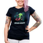 Space Craft Junior's t-shirt model TeeTurtle navy t-shirt featuring a green alien gloating in space with big eyes looking down at a pink scarf they are knitting with crafting supplies floating around them as well as planets and stars in the background