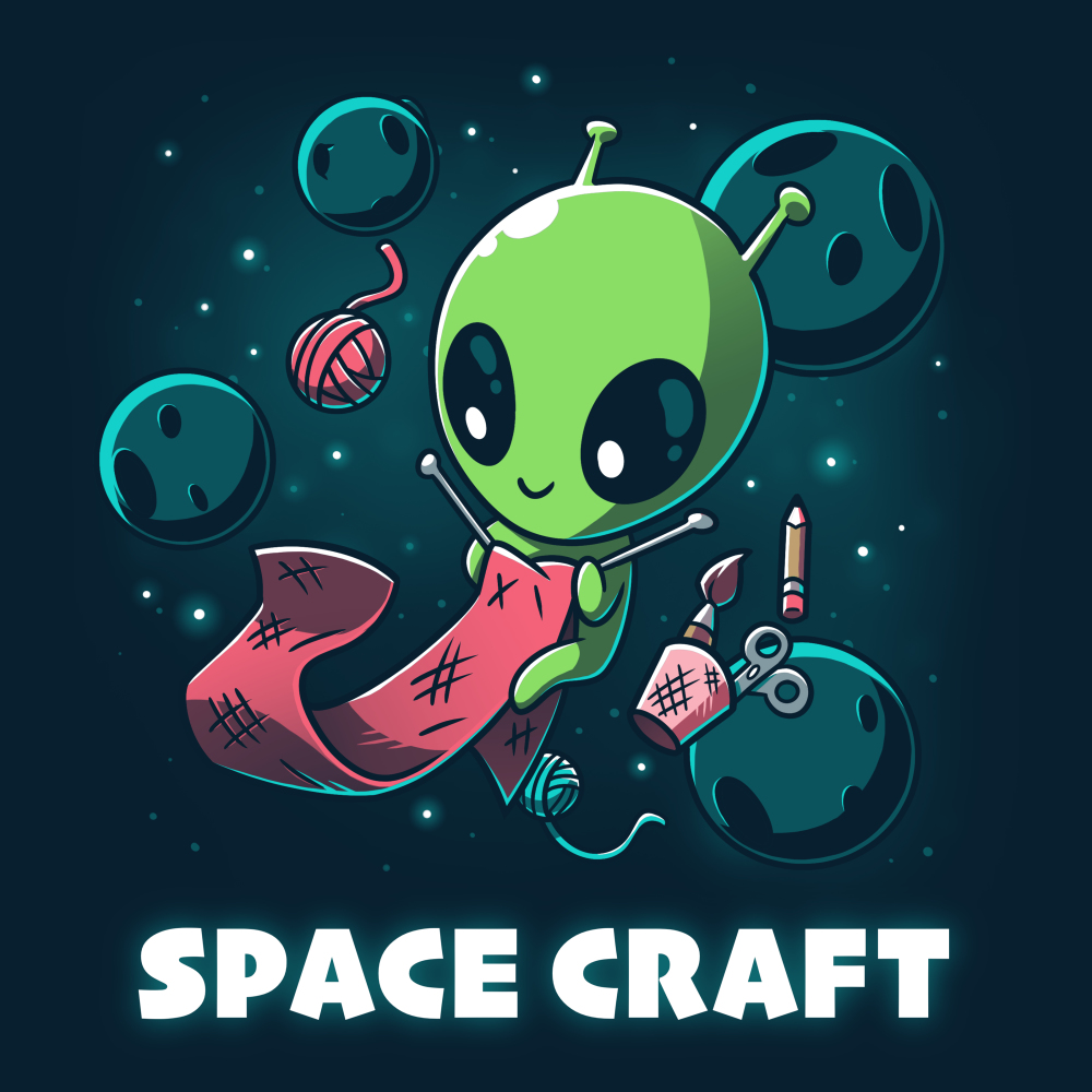 Space Craft t-shirt TeeTurtle navy t-shirt featuring a green alien gloating in space with big eyes looking down at a pink scarf they are knitting with crafting supplies floating around them as well as planets and stars in the background