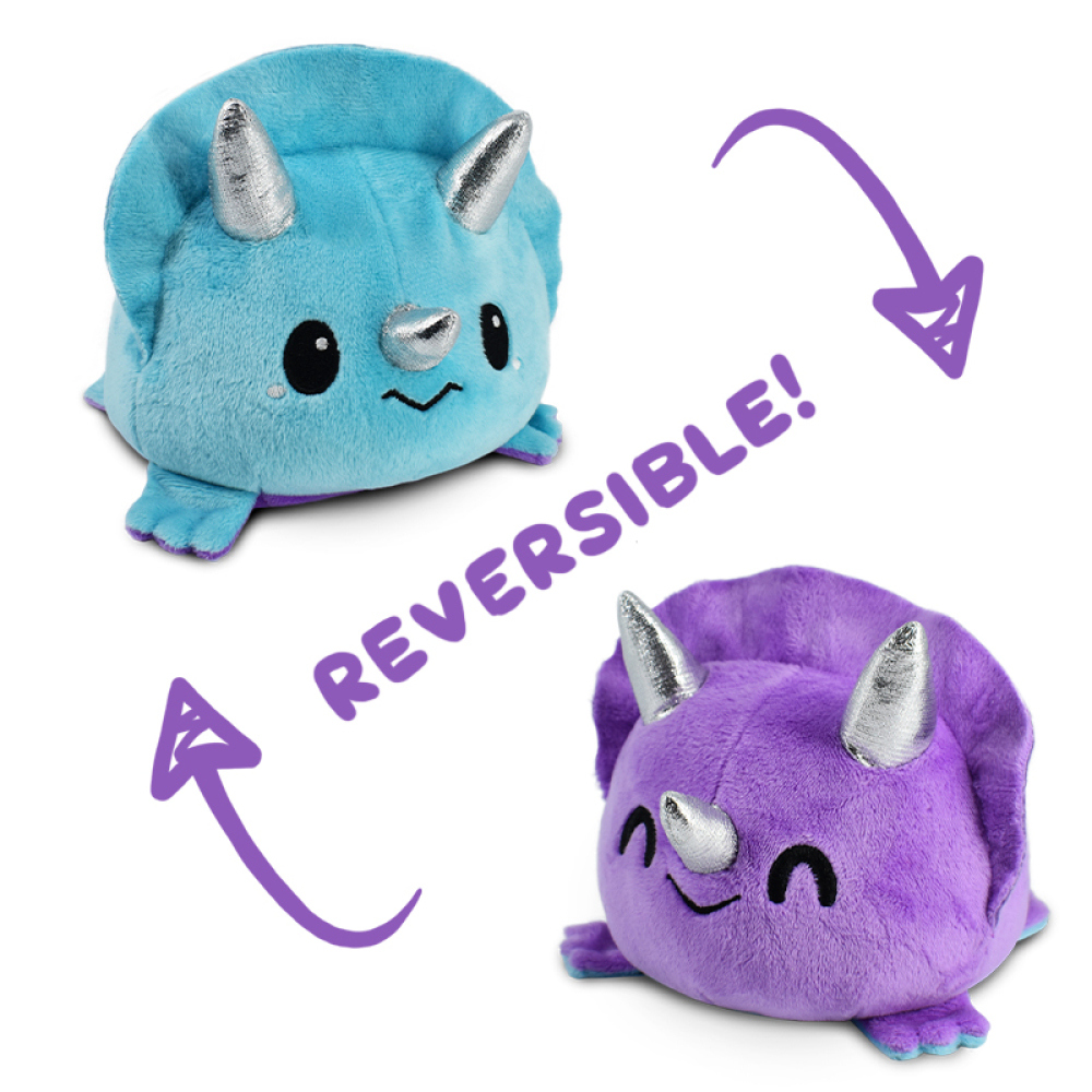 A sad blue triceratops plushie flipping to a happy purple triceratops plushie.