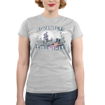Adventure is Out There Junior's t-shirt model TeeTurtle silver t-shirt featuring a jungle landscape with two cats with backpacks looking at a big dragon on top of a mountain with a sun and clouds behind him all on top of the tree line