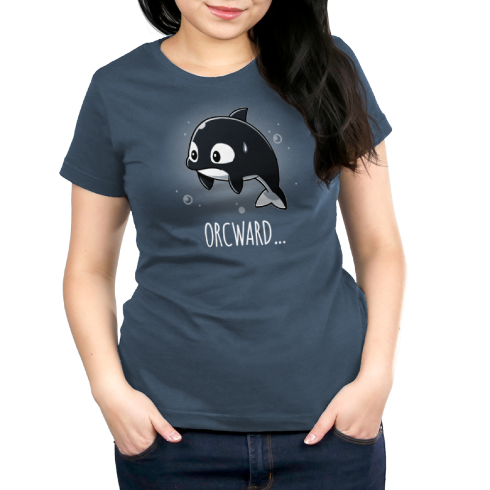Orcward Women's t-shirt model TeeTurtle denim blue t-shirt featuring an orca whale floating in water looking anxious with its fins at its side and a sweat droplet on its face with bubbles around them