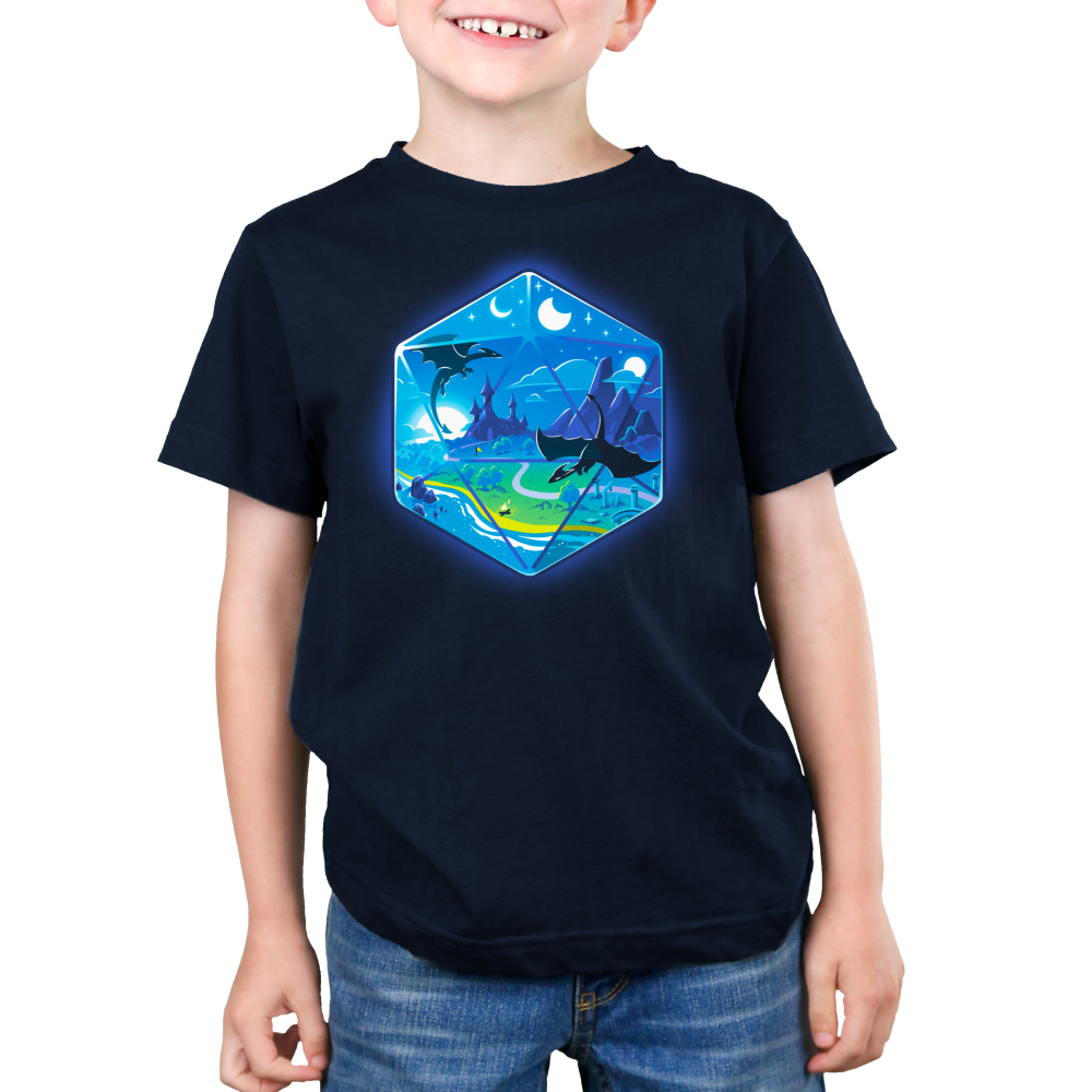 D20 Landscape Kid's t-shirt model TeeTurtle navy t-shirt featuring the outline of a D20 dice a fantasy landscape inside including moons, a castle in a green prairie, mountains, and two dragons flying in the sky