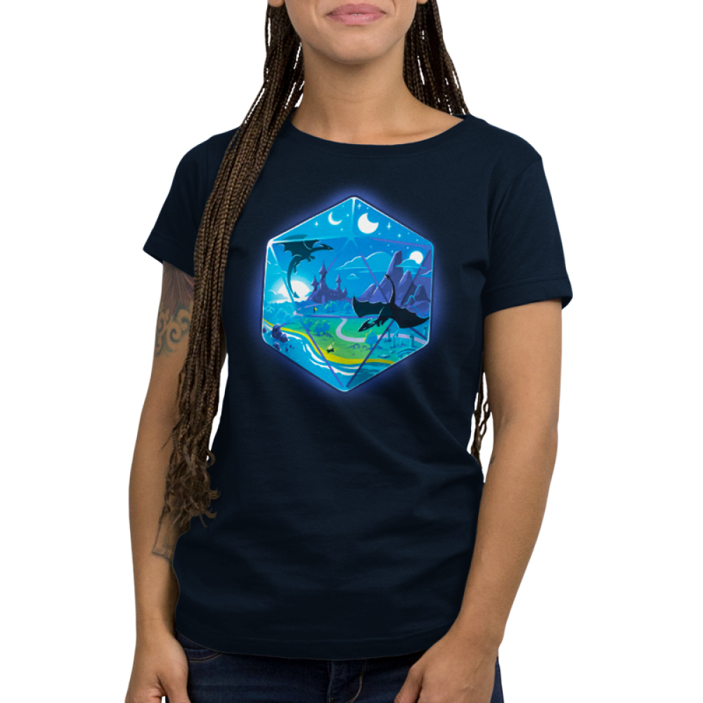 D20 Landscape Women's t-shirt model TeeTurtle navy t-shirt featuring the outline of a D20 dice a fantasy landscape inside including moons, a castle in a green prairie, mountains, and two dragons flying in the sky