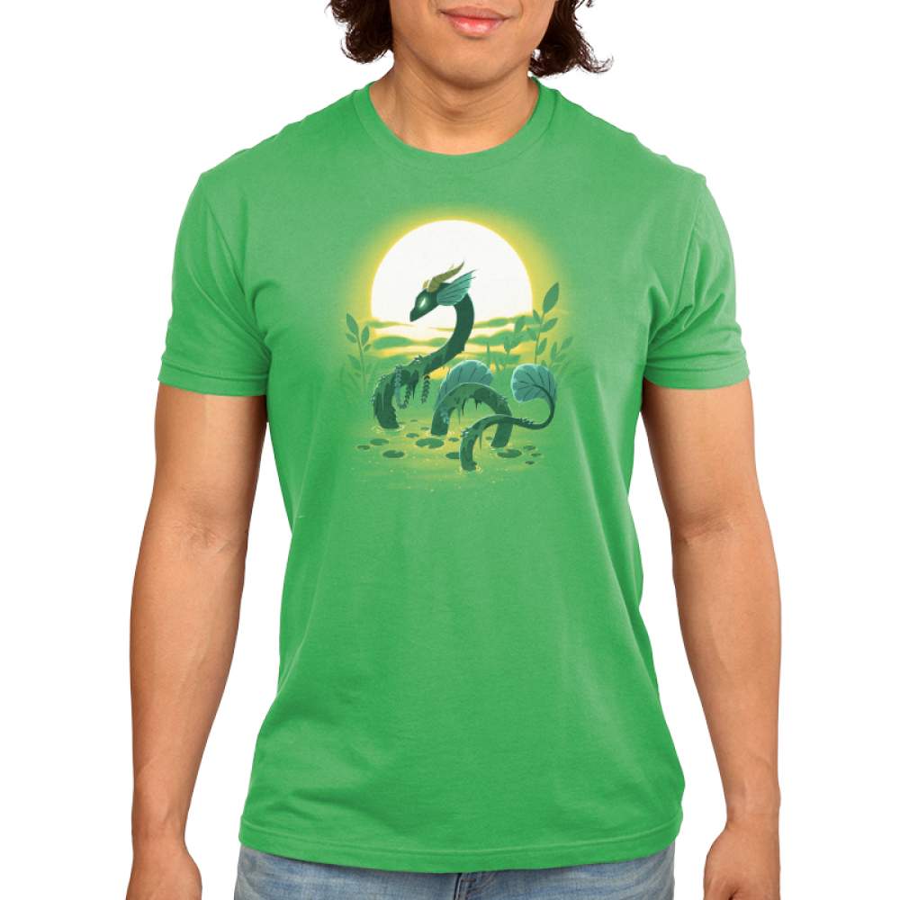 Swamp Dragon Men's t-shirt model TeeTurtle apple green t-shirt featuring a dark green dragon coming out of a green swamp with miss and leaves draping over its body with a sun and plants behind him