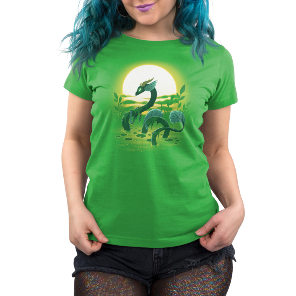 Swamp Dragon Women's t-shirt model TeeTurtle apple green t-shirt featuring a dark green dragon coming out of a green swamp with miss and leaves draping over its body with a sun and plants behind him