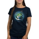 Cup of Koi Women's t-shirt model TeeTurtle navy t-shirt featuring a white tea cup with two orange and white koi fish swimming in it with lily pads and plants in the tea cup with the fish and on the plate the tea cup is on