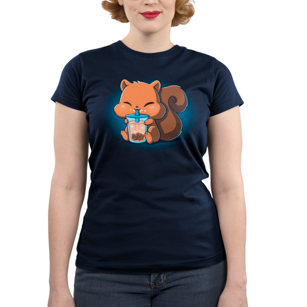 Boba Squirrel Junior's t-shirt model navy t-shirt featuring a cute brown squirrel with big chubby cheeks sitting down with its arms and feed holding a big boba cup which its drinking out of