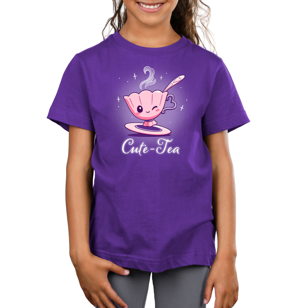 Cute-Tea Kid's t-shirt model TeeTurtle purple t-shirt featuring a cute little pink tea cup with a pink saucer and pink spook smiling and giving a wink with steam coming out of its cup and sparkles behind them