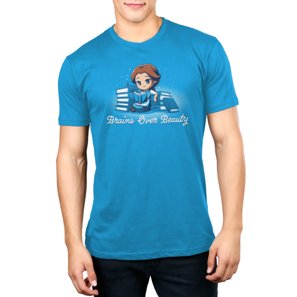 Brains Over Beauty mens tshirt model officially licensed cobalt blue tshirt featuring Belle reading and surrounded by books