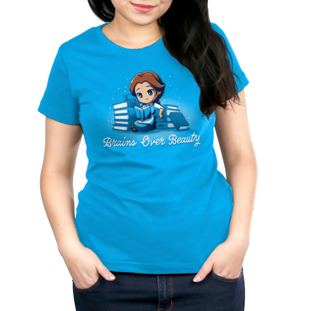 Brains Over Beauty womens tshirt model officially licensed cobalt blue tshirt featuring Belle reading and surrounded by books