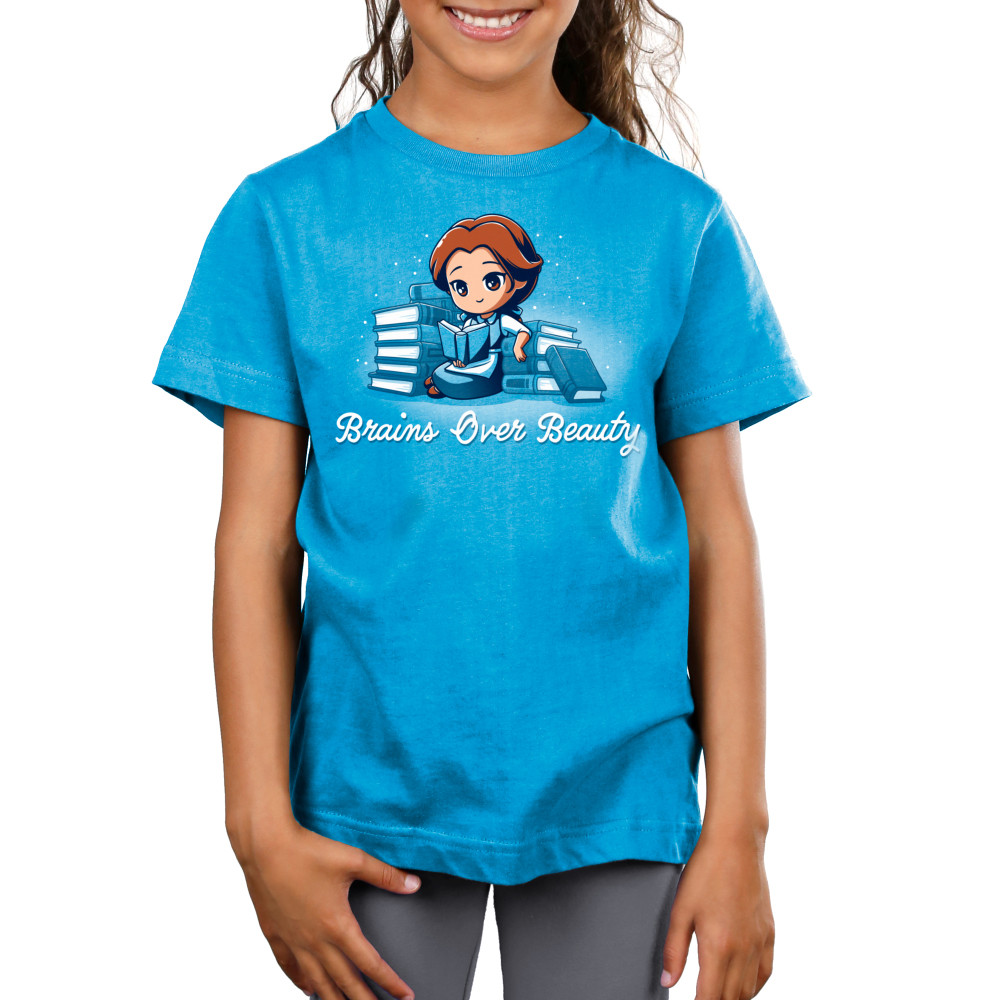 Brains Over Beauty kids tshirt model officially licensed cobalt blue tshirt featuring Belle reading and surrounded by books