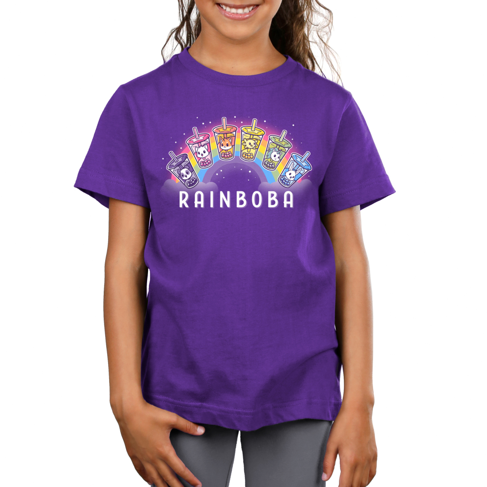 Rainboba Kid's t-shirt model TeeTurtle purple t-shirt featuring a rainbow in the background with 6 boba cups in front of its shape all in different colors of the rainbow and animals within the cups, purple with panda, pink with cat, orange with fox, yellow with axolotl, green with unicorn, and blue with bunny
