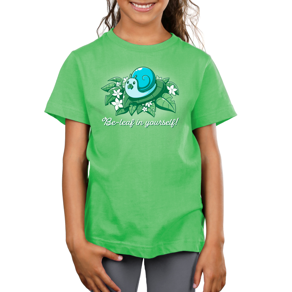 Be-leaf in Yourself! Women's t-shirt model TeeTurtle apple green t-shirt featuring a light blue snail eating a life in its mouth on a pile of green leaves and white flowers