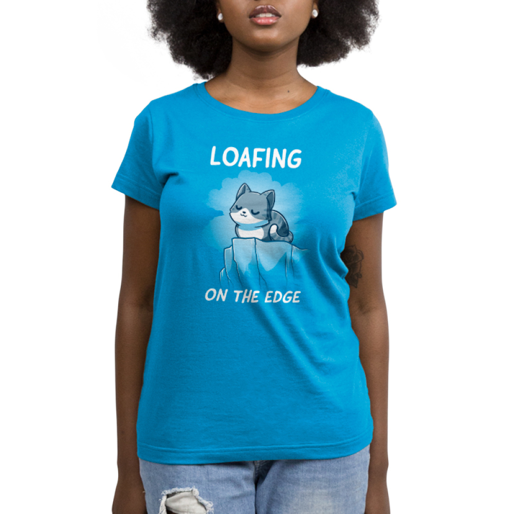 Loafing on the edge cobalt blue womens  tshirt model  featuring a cat curled up on the edge of a cliff
