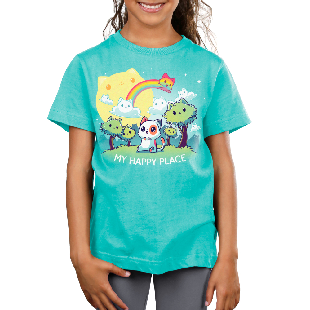 My Happy Place (Cats) kids tshirt model featuring a cat sitting in a forest of cat trees, with cat clouds and a cat sun, and a cat rainbow