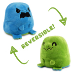 An angry blue t-rex plushie flipping to a happy green t-rex plushie.