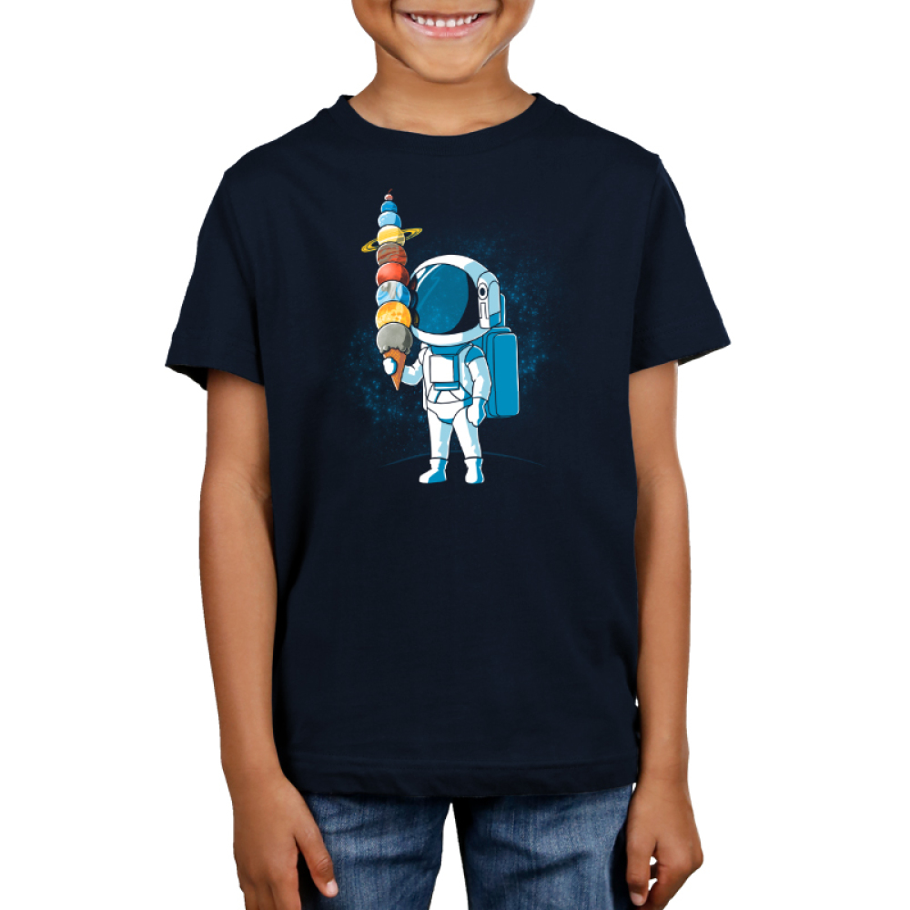 Astronaut Ice Cream Kid's t-shirt model TeeTurtle blue t-shirt featuring an astronaut holding an ice cream cone with the planets as the ice cream scoops