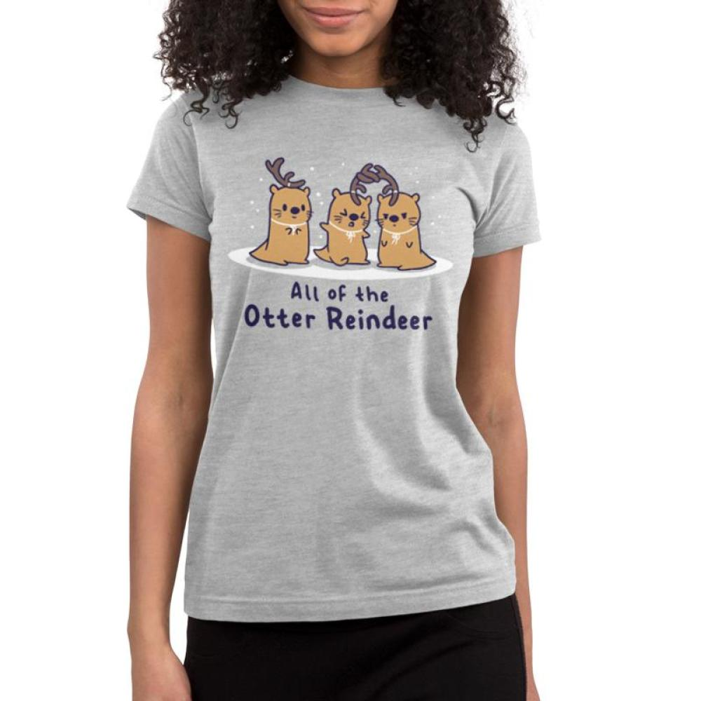All of the Otter Reindeer Juniors T-Shirt Model TeeTurtle gray t-shirt with three brown otters wearing antlers on their heads with snow falling around them with shirt text