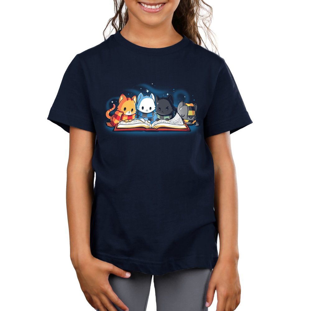 Books are Magic Kids T-Shirt Model TeeTurtle Blue t-shirt featuring 4 different colored cats reading a book with sparkles behind them
