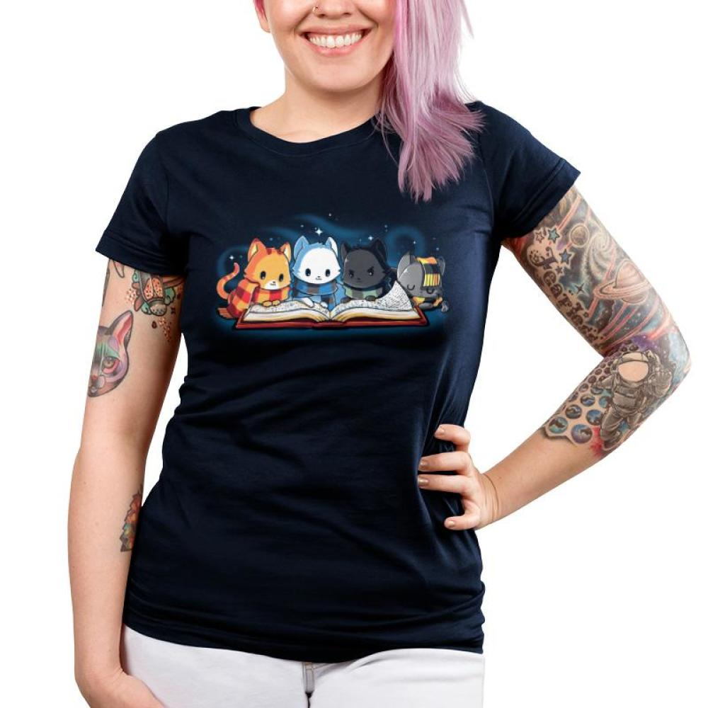 Books are Magic Juniors T-Shirt Model TeeTurtle Blue t-shirt featuring 4 different colored cats reading a book with sparkles behind them