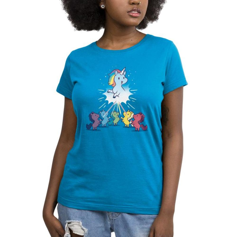 Captain Unicorn Women's T-Shirt Model TeeTurtle blue t-shirt featuring a blue unicorn with a rainbow mane up in the sky while several other colorful unicorns look up at it in awe