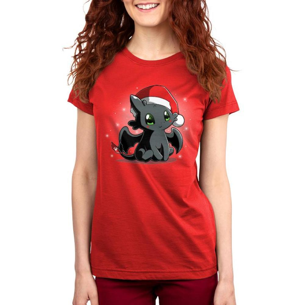 Christmas Toothless Women's T-Shirt model TeeTurtle red t-shirt with Toothless wearing a Santa hat with white sparkles/snowflakes in the background