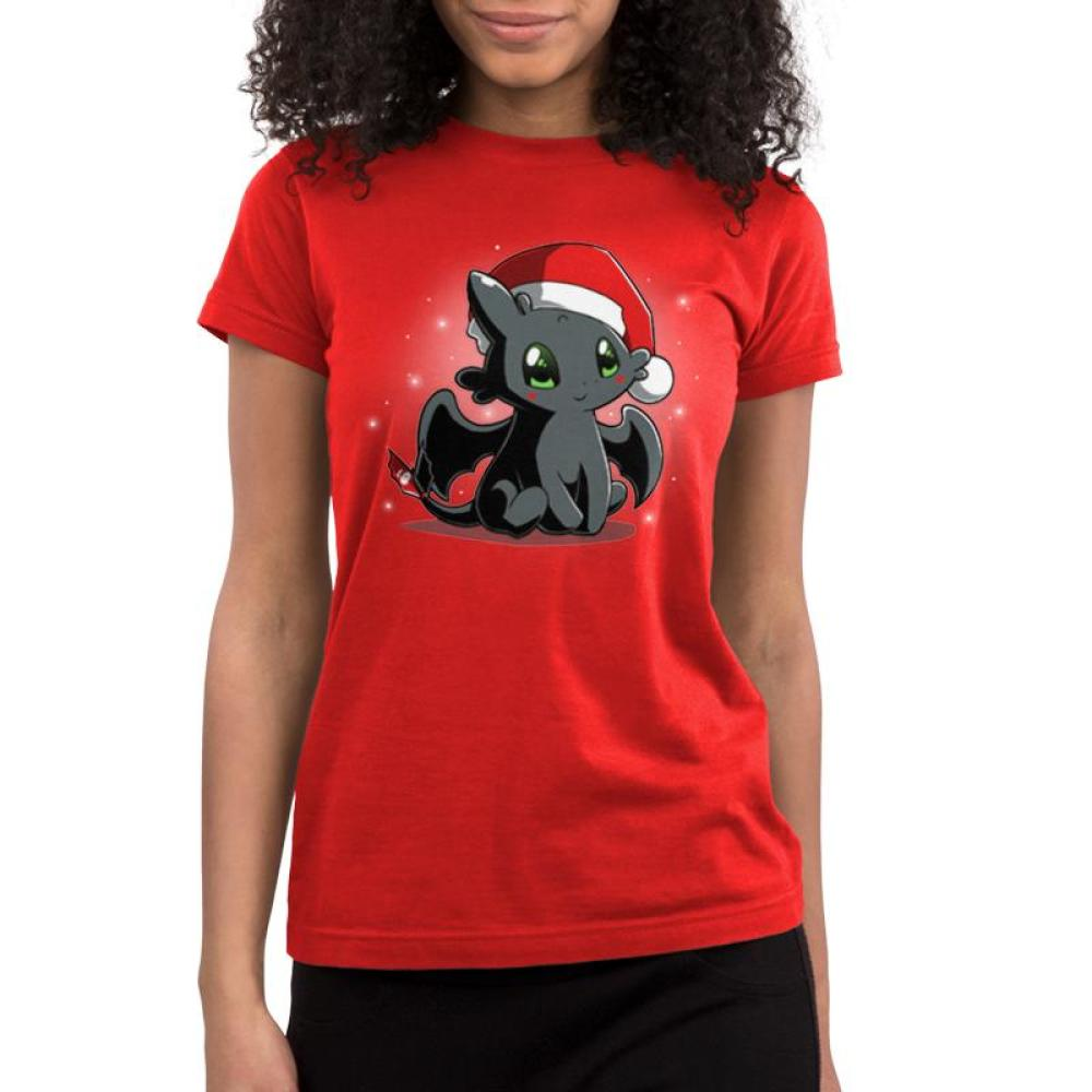 Christmas Toothless Juniors T-Shirt model TeeTurtle red t-shirt with Toothless wearing a Santa hat with white sparkles/snowflakes in the background