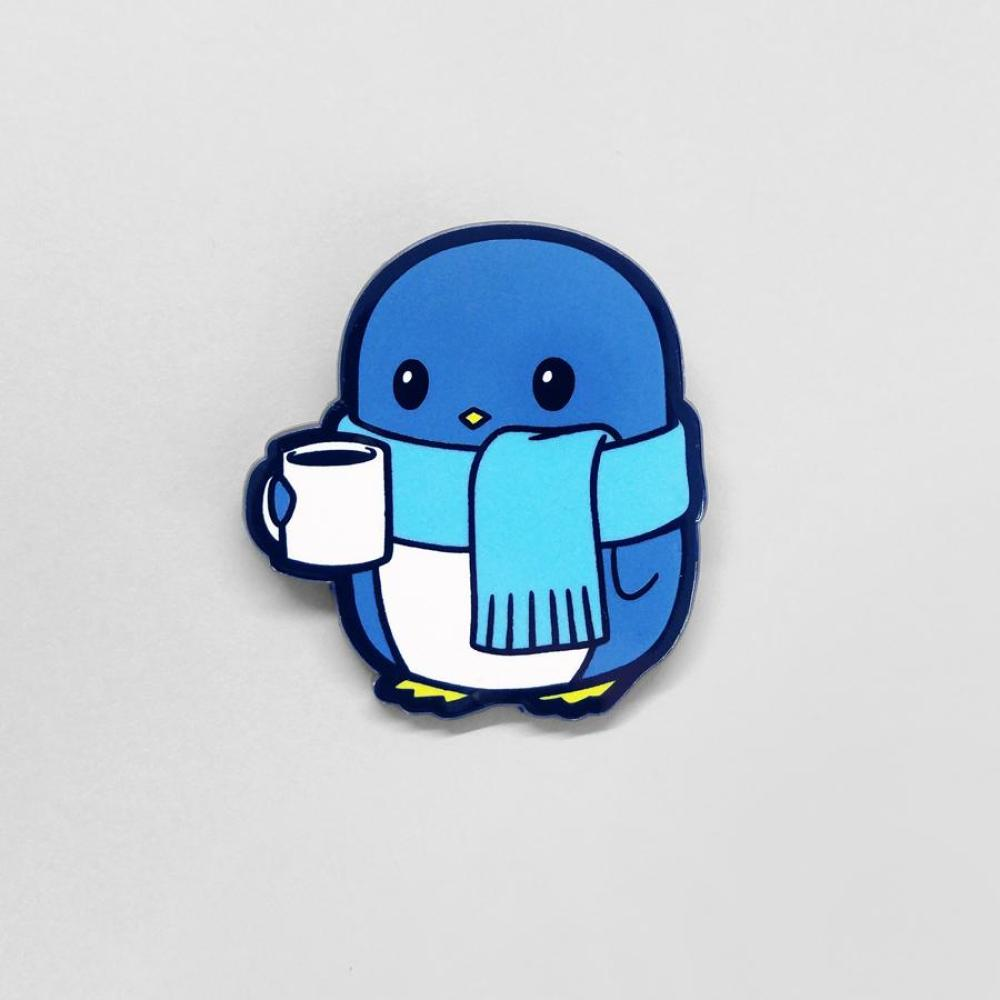 Cold Penguin Charm Pin TeeTurtle Blue penguin wearing a scarf and holding a mug