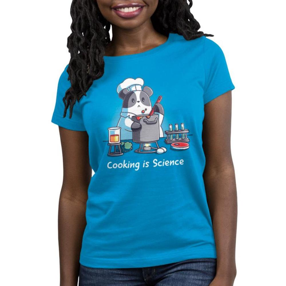 Cooking is Science women's t-shirt model TeeTurtle blue t-shirt featuring a panda wearing a chef's outfit cooking while different science tools are around him with shirt text