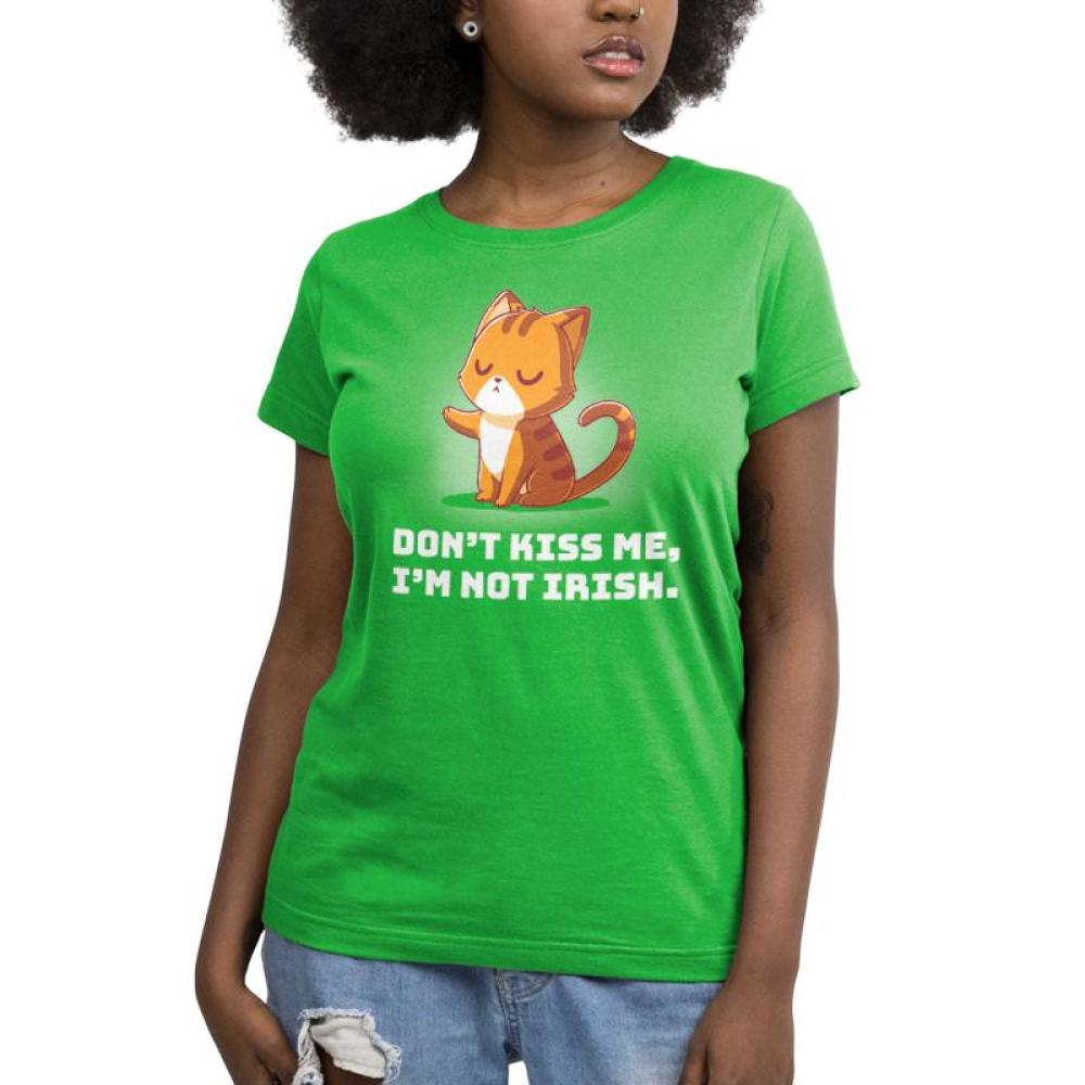 Don't Kiss Me Women's T-shirt Model TeeTurtle green t-shirt featuring an orange cat holding out its paw in a defiant way with shirt text