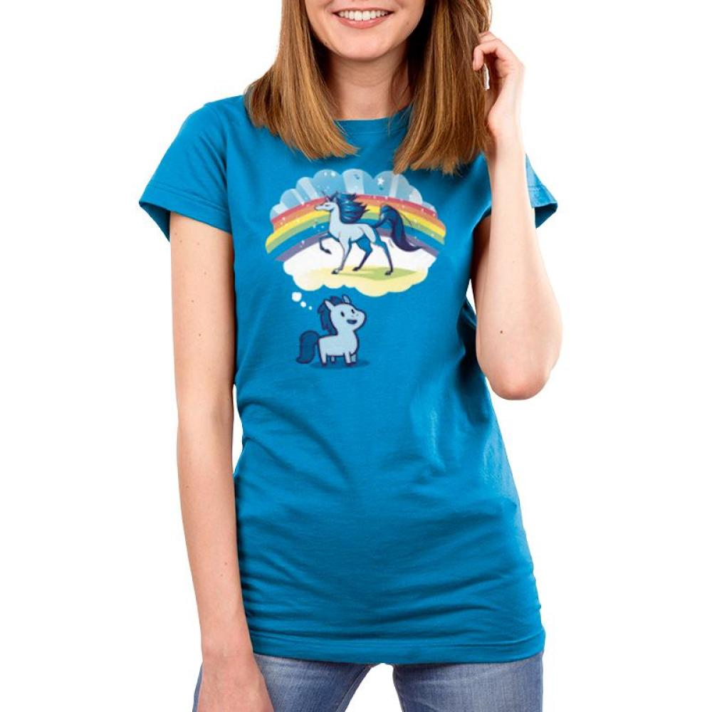 Dream Big, Little Horsey Womens T-Shirt ModelTeeTurtle blue t-shirt featuring a pony with a thought bubble over its head and in the thought bubble is a majestic horse with a rainbow behind it