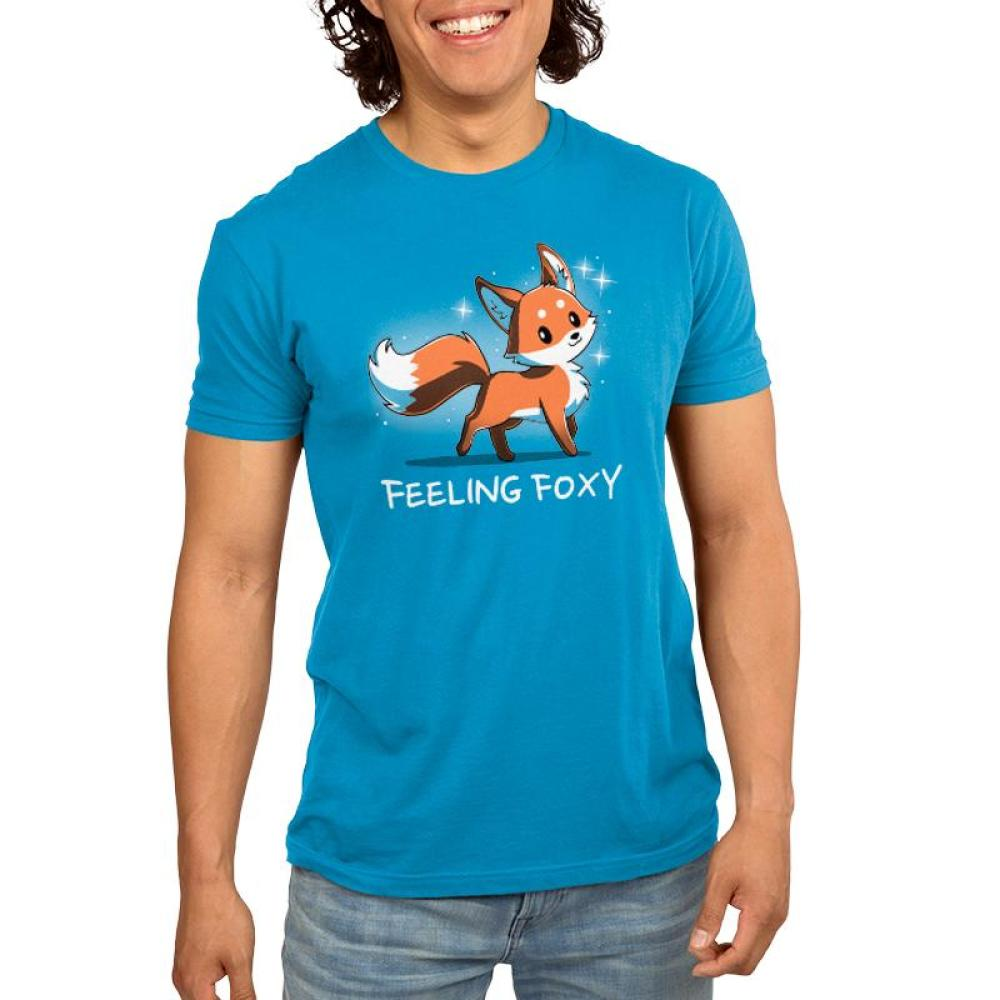 Feeling Foxy Men's T-Shirt model TeeTurtle Blue t-shirt with a red orange fox with sparkles around him and shirt text