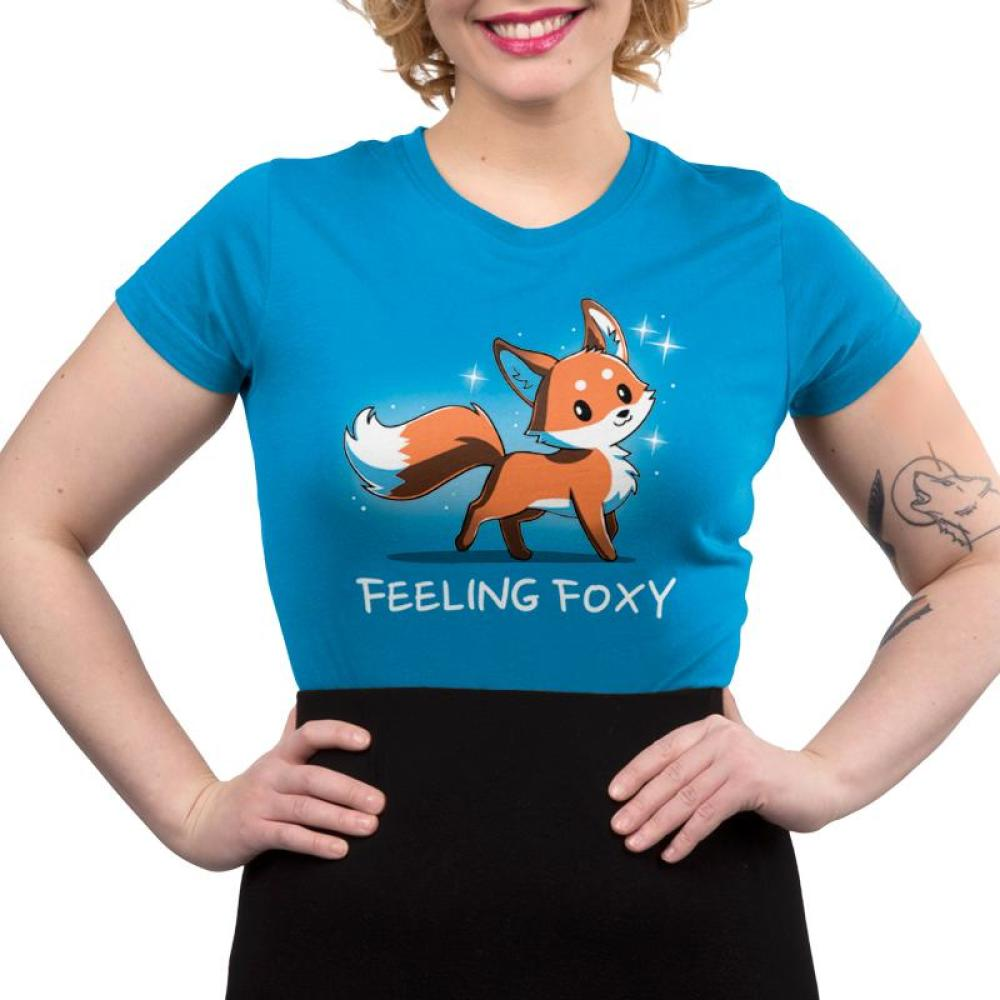 Feeling Foxy Women's T-Shirt model TeeTurtle Blue t-shirt with a red orange fox with sparkles around him and shirt text