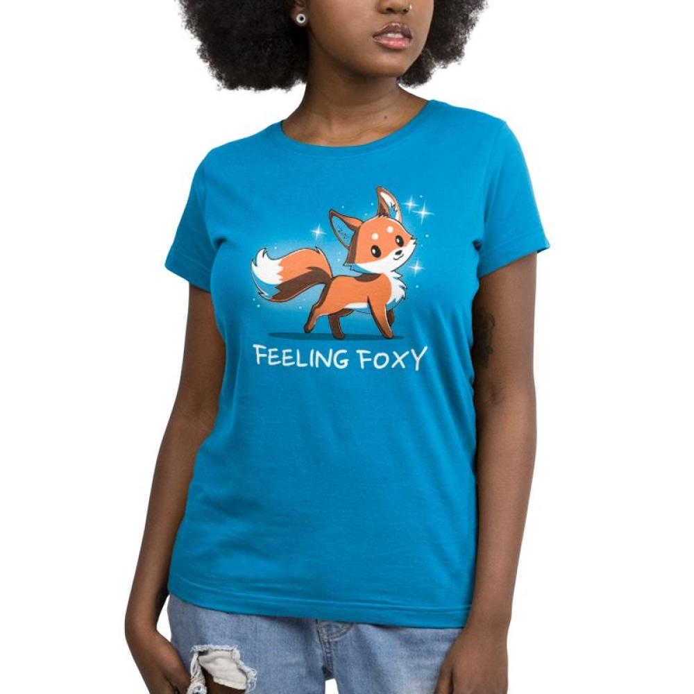 Feeling Foxy Juniors T-Shirt model TeeTurtle Blue t-shirt with a red orange fox with sparkles around him and shirt text