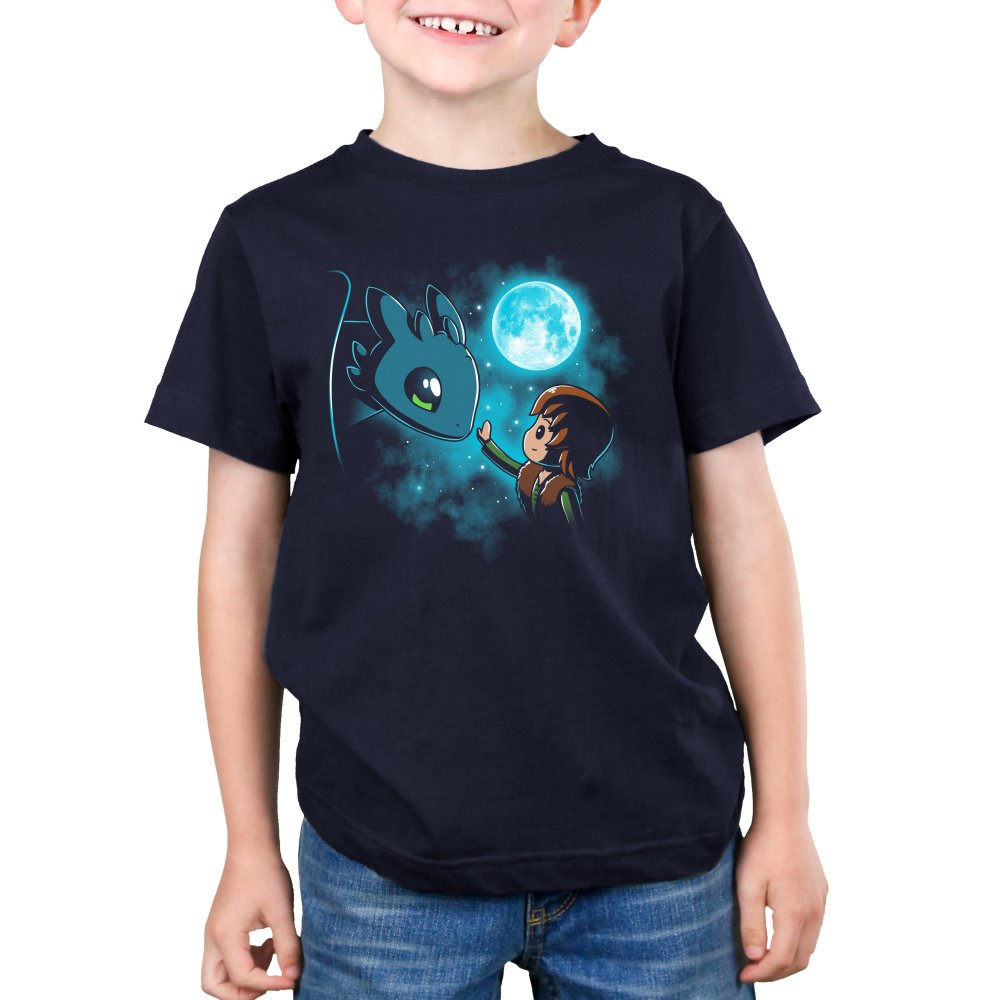 How to Train Your Dragon Kids T-shirt Model Dreamworks TeeTurtle blue t-shirt featuring Hiccup and Toothless from How to Train Your Dragon with the moon and stars behind them