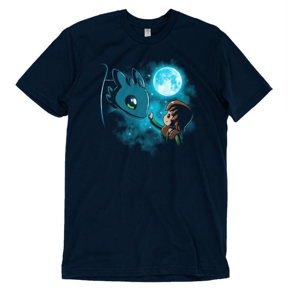 How to Train Your Dragon T-shirt Dreamworks TeeTurtle blue t-shirt featuring Hiccup and Toothless from How to Train Your Dragon with the moon and stars behind them