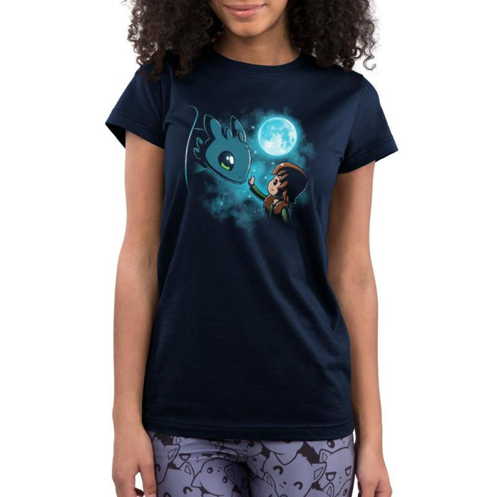 How to Train Your Dragon Juniors T-shirt Model Dreamworks TeeTurtle blue t-shirt featuring Hiccup and Toothless from How to Train Your Dragon with the moon and stars behind them