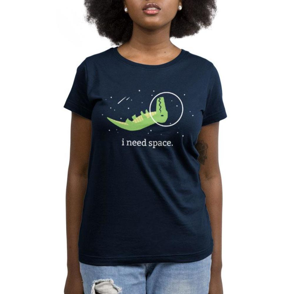 I Need Space Women's T-Shirt Model TeeTurtle black t-shirt with a green dinosaur wearing a helmet floating upside in space with shirt text