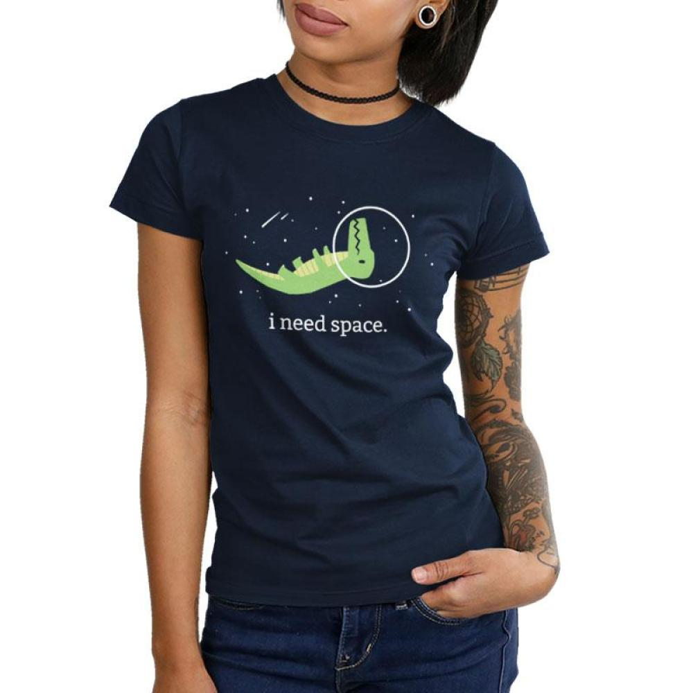 I Need Space Juniors T-Shirt Model TeeTurtle black t-shirt with a green dinosaur wearing a helmet floating upside in space with shirt text