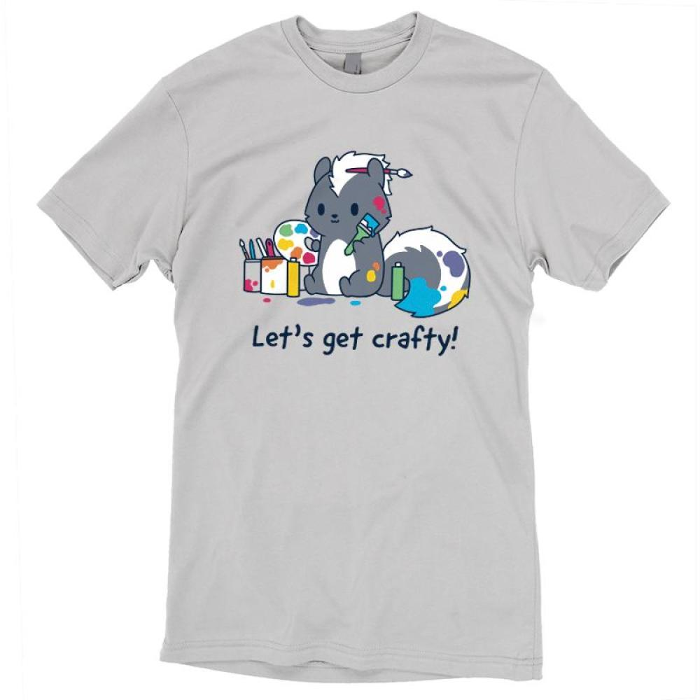 Let's Get Crafty! T-Shirt TeeTurtle Gray t-shirt featuring a skunk covered in paint and holding a paint brush and a palette while surrounded by paint cans with shirt text reading