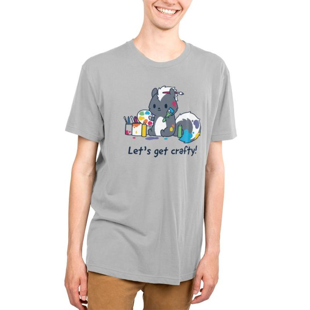 Let's Get Crafty! Men's T-Shirt Model TeeTurtle Gray t-shirt featuring a skunk covered in paint and holding a paint brush and a palette while surrounded by paint cans with shirt text reading
