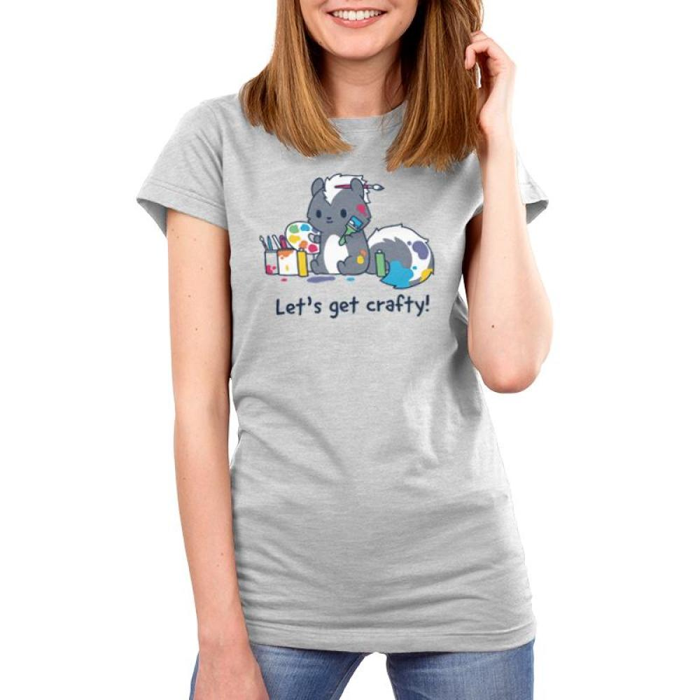 Let's Get Crafty! Women's T-Shirt Model TeeTurtle Gray t-shirt featuring a skunk covered in paint and holding a paint brush and a palette while surrounded by paint cans with shirt text reading