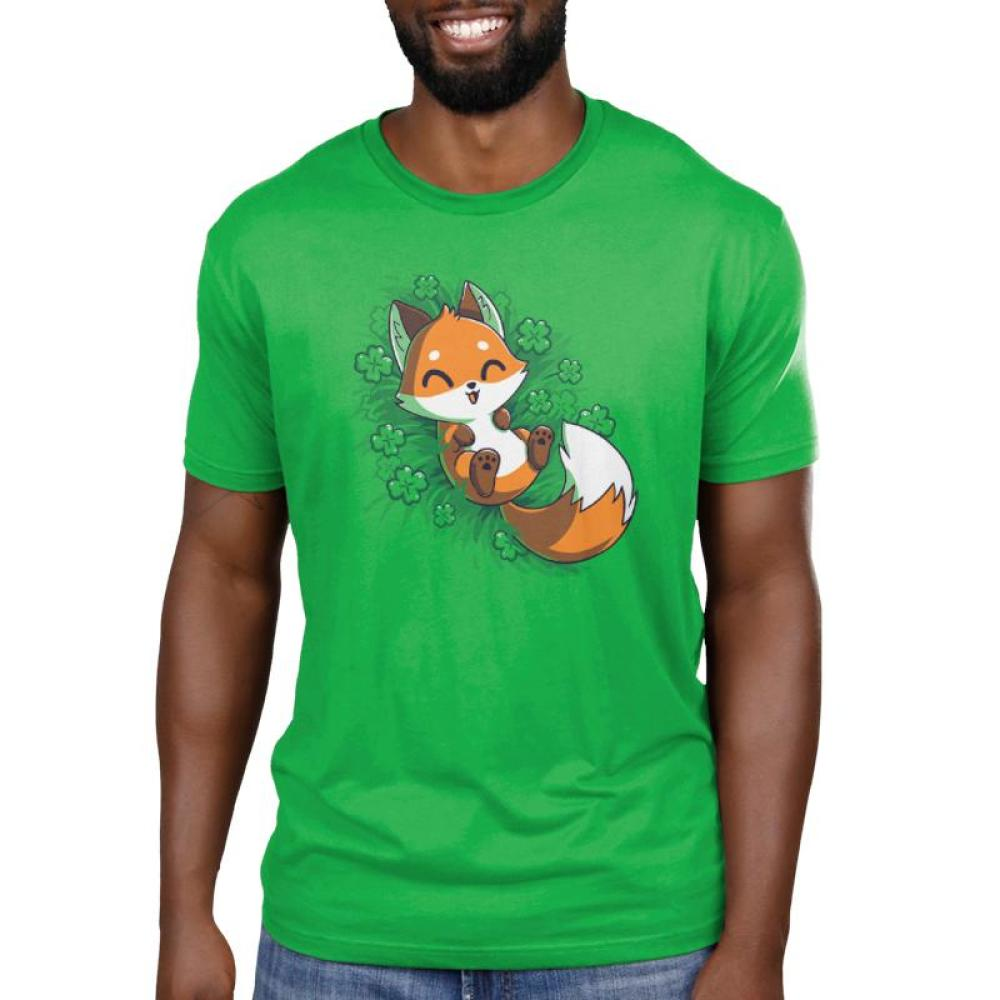 Lucky Fox Men's T-shirt Model TeeTurtle green t-shirt featuring an orange fox lying in a field of four leaf clovers