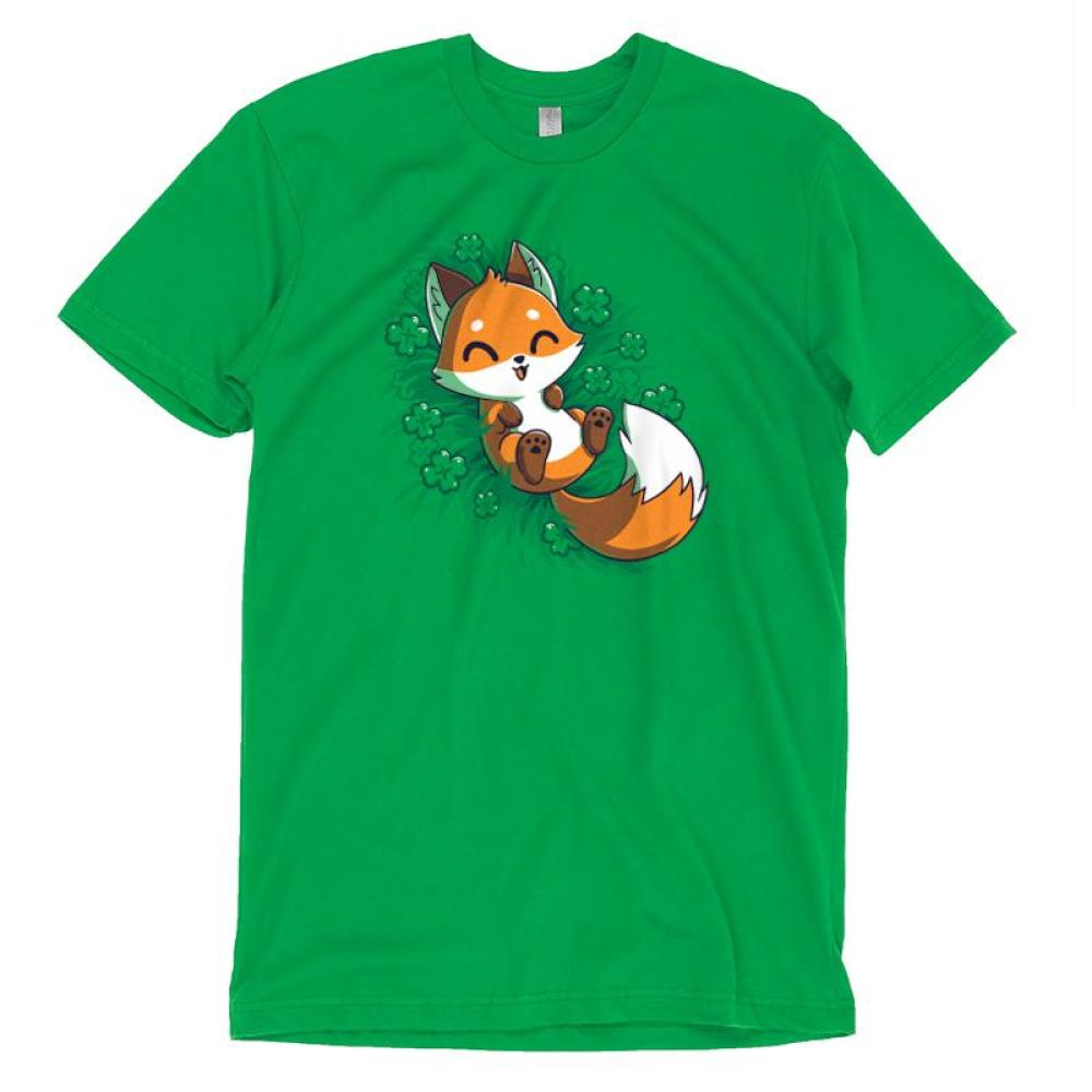 Lucky Fox T-shirt TeeTurtle green t-shirt featuring an orange fox lying in a field of four leaf clovers