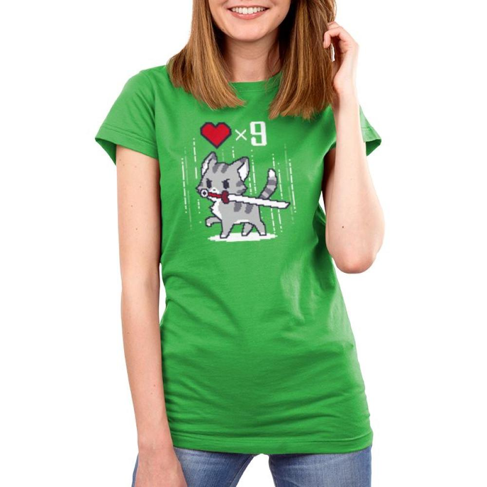 Nine Lives Womens T-Shirt Model TeeTurtle green t-shirt featuring a gray cat holding a sword in its mouth with a