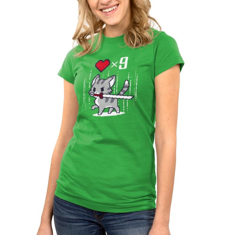 Nine Lives Juniors T-Shirt Model TeeTurtle green t-shirt featuring a gray cat holding a sword in its mouth with a