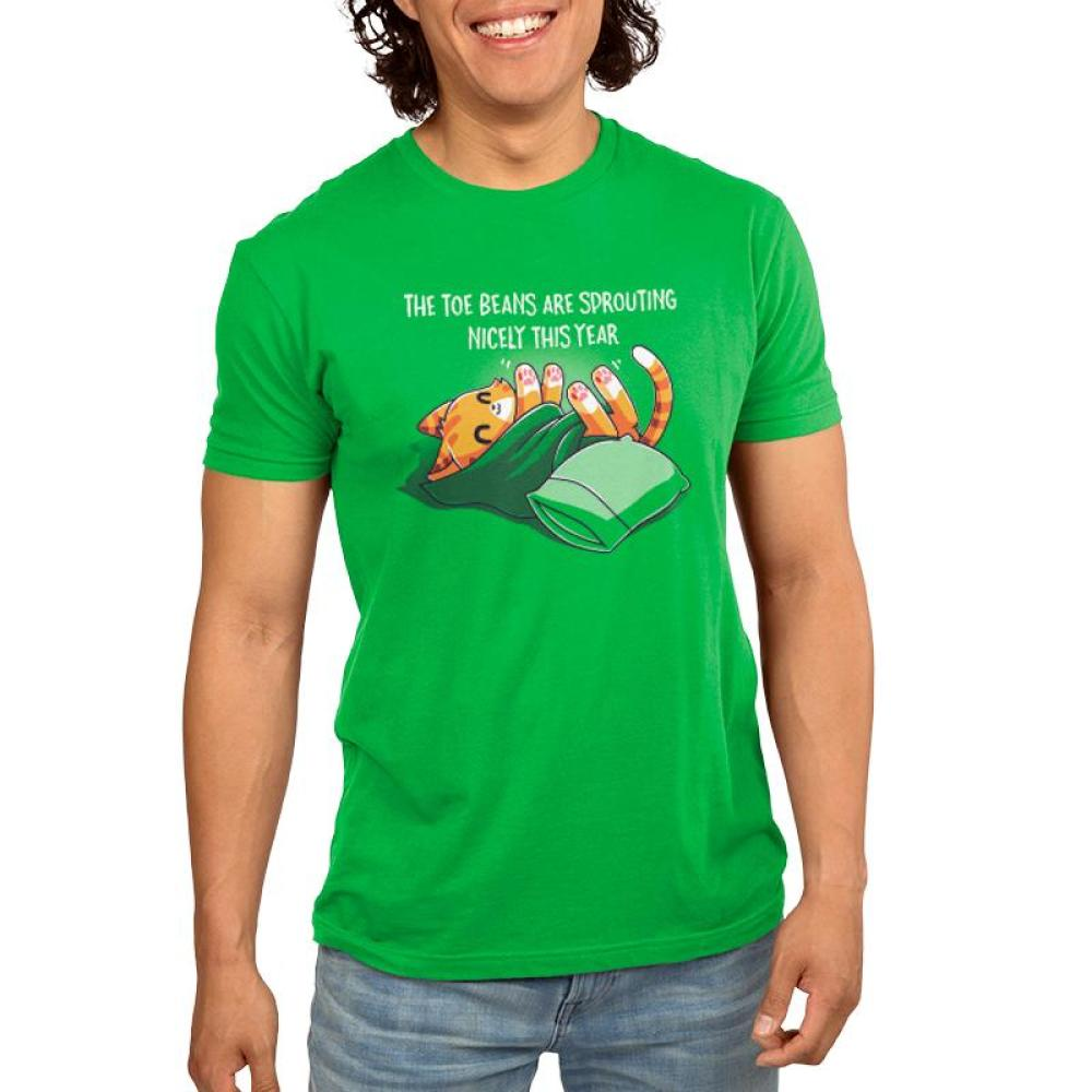 Toe Beans Men's T-shirt Model TeeTurtle green t-shirt featuring an orange cat wrapped up in a green blanket with a pillow next to him and shirt text